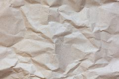 Abstract texture. Crumpled craft brown paper background. Copy space for text. Horizontal. DIY, handicraft, back to school concept. Abstract texture. Crumpled stock photos