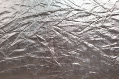 Abstract texture. Crumpled silver metallic shiny fabric background. Copy space for text. Horizontal and vertical. stock images