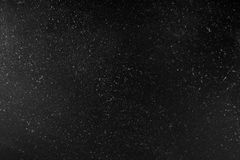 Abstract texture with dust and spots of light. Black tone glitter background Royalty Free Stock Photo