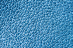 Abstract texture of genuine blue leather close-up, for degner background , backdrop, substrate, composition use, place. Texture of background for a designer Royalty Free Stock Photos