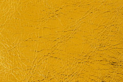 Abstract texture of genuine leather close-up, orange, for background , backdrop, substrate, composition use, place for. Abstract texture of genuine leather close Royalty Free Stock Photography