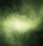 Abstract texture of green smoke on a black background Stock Photos
