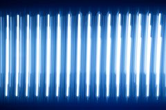 Abstract texture luminous light strips. blue glow. a lot of light rays halogen diodes bright substrate dark wallpaper. Abstract texture luminous light strips Stock Image