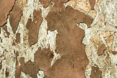 Abstract texture of peeling plaster brown color Stock Photos