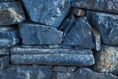 Abstract texture of a rustic vintage blue stone wall Stock Photo