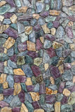 Abstract texture of the stone masonry colored stone. Stone wall. Stock Images