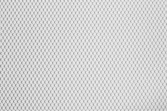 Abstract Texture of vinyl paper perforated sheets white color. Royalty Free Stock Photos