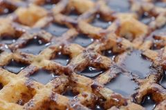 Waffle with melted chocolate. Abstract texture of waffle with melted chocolate Royalty Free Stock Images