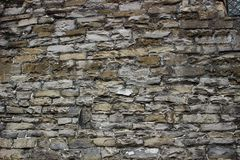 An abstract texture of wall. A medieval masonry from large grey stones. An abstract texture of wall for design and background. A medieval masonry from large grey stock photos