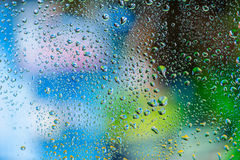 Abstract texture. Water drops on glass with colorful background Royalty Free Stock Photo