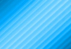 Abstract textured background. Blurred blue image from stripes. Light middle. Stock Photos