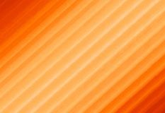 Abstract textured background. Blurred orange image from stripes. Stock Images