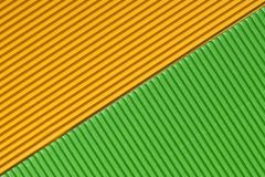 Textured colorful yellow and green corrugated cardboard royalty free stock photo