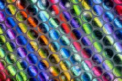 Abstract close up bubble wrap sheet with colorful background stock image