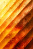 Abstract textured background in orange and yellow. Abstract textured background made of diagonal stripes in orange and yellow tones Royalty Free Stock Photo
