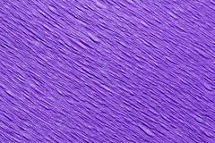 Abstract textured background of purple crepe paper royalty free stock photos