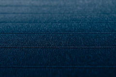 Abstract textured  minimalist deep blue background with horizontal lines Royalty Free Stock Photos