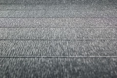 Abstract textured  minimalist grey background with horizontal lines. Royalty Free Stock Images