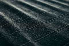 Abstract textured velvety dark background with diagonal lines. The texture Royalty Free Stock Photos
