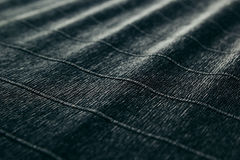 Abstract textured velvety dark background with diagonal lines. Stock Photos
