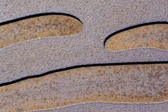 Abstract Textures and Backgrounds: Corroding Metal Curves. Abstract textures and backgrounds: two toned etched and corroding metal with waving, curvy lines royalty free stock photo