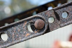 Abstract Textures and Shapes: Aging Metal Chain Plates and Bolts Stock Photography