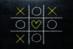 Abstract Tic Tac Toe Game Competition with heart shape in the ce royalty free stock photography