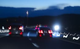 Abstracts. Abstract tones. Grain. Blurred. Night road and low speed shutter light at highway stock images