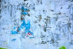 Abstract torn posters. Colorful torn posters on grunge old walls as creative and abstract background Stock Images