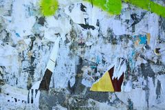 Abstract torn posters. Colorful torn posters on grunge old walls as creative and abstract background Stock Photos