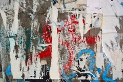 Abstract torn posters. Colorful torn posters on grunge old walls as creative and abstract background Stock Photo