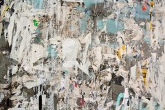 Abstract torn posters. Colorful torn posters on grunge old walls as creative and abstract background Royalty Free Stock Photos