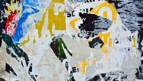 Abstract torn posters. Colorful torn posters on grunge old walls as creative and abstract background Royalty Free Stock Photography