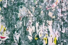 Abstract torn posters. Colorful torn posters on grunge old walls as creative and abstract background Stock Image