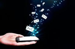 Abstract, touching mobile phone, flying envelopes. Royalty Free Stock Image