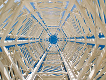Abstract tower sculpture. Abstract view of a tower sculpture located in San Francisco.  Taken from low perspective upward through middle of sculpture, with blue Royalty Free Stock Images