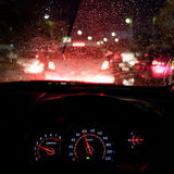 Abstract traffic accident  in raining day. View from car seat. Royalty Free Stock Photos