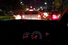Abstract traffic jam  in raining day. View from car seat. Stock Photos
