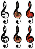 Abstract treble clefs. Set of abstract treble clefs from piano keys, guitar and violin Royalty Free Stock Photography
