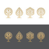Abstract tree logos. Set of abstract golden tree logos, icons, symbols Stock Images