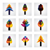 Abstract trees icons of pine, christmas - vector graphic. This graphic shows trees with leaves in different colors like yellow, orange, red, blue, pink, etc Royalty Free Stock Photo