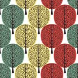 Abstract trees seamless pattern, stylized forest, vintage drawing. Ornate trunks with branches and green, yellow and orange crown. Foliage on white background stock illustration