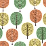 Abstract trees seamless pattern, vector illustration, stylized autumn forest, vintage drawing. Ornate tree trunks with branches an. D pastel green, yellow and vector illustration
