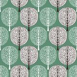 Abstract trees seamless pattern, vector illustration, stylized forest, vintage drawing. Ornate brown and white tree trunks with br. Anches and crown foliage on vector illustration