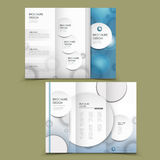 Abstract tri-fold brochure design. With circular element in blue and white Stock Photos
