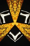 Abstract triangular design. Abstract golden triangular design with black background Stock Photo