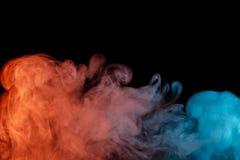 Abstract turquoise orange smoke Weipa stock photography