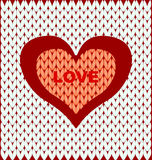 Abstract two hearts on a light knitted background Stock Photos