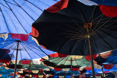 Abstract under big umbrella Stock Photo