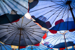 Abstract under big umbrella stock photography